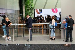 apple-customers-social-distance-line-outside-apple-store-bondi-junction-may-07-2020-sydney-australia-1937271